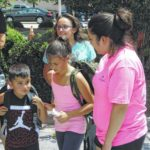 Hundreds turn out for second backpack giveaway