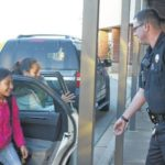 City police officers open doors at Gallman